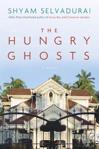 Book cover for Shyam Selvadurai's The Hungry Ghosts showing a house behind a gate under a blue sky with palm trees behind the house